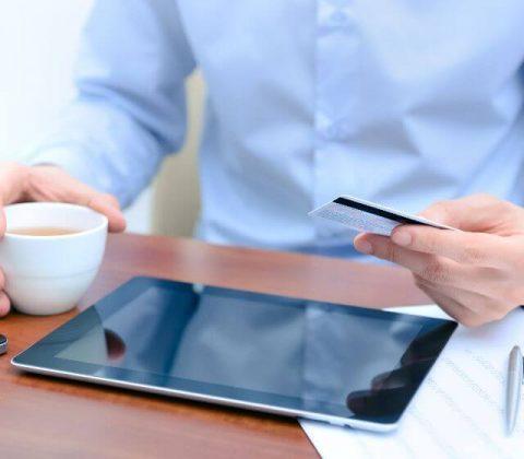 photo-sliver-businessman-using-a-credit-card-and-digital-tablet